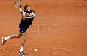 Benoit Paire of France plays Kei Nishikori of Japan during their men?s round of 16 match during the French Open tennis tournament at Roland Garros in Paris, France, 03 June 2019. EPA-EFE/YOAN VALAT