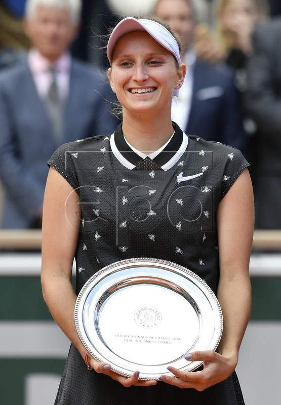 Marketa Vondrousova of the Czech Republic poses with the runner-up trophy after losing the women?s final match during the French Open tennis tournament at Roland Garros in Paris, France, 08 June 2019. EPA-EFE/JULIEN DE ROSA