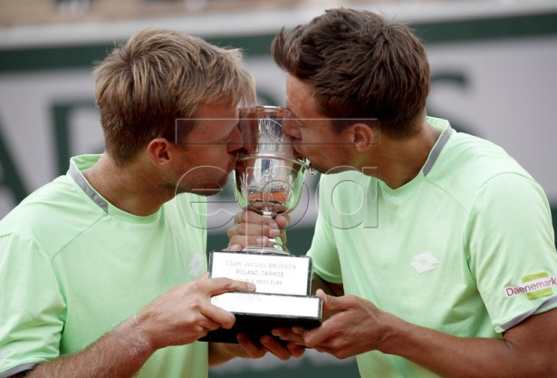 Kevin Krawietz (L) and Andreas Mies of Germany pose with the trophy after winning the men?s doubles final match during the French Open tennis tournament at Roland Garros in Paris, France, 08 June 2019. EPA-EFE/YOAN VALAT