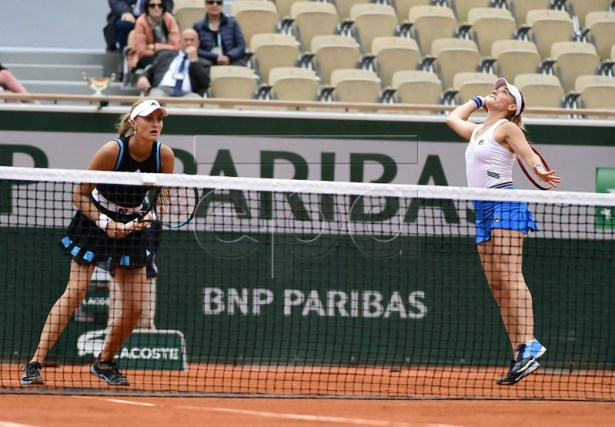 Timea Babos of Hungary (R) and Kristina Mladenovic of France play Zheng Saisai and Duan Yingying of China during the women?s doubles final match during the French Open tennis tournament at Roland Garros in Paris, France, 09 June 2019. EPA-EFE/CAROLINE BLUMBERG