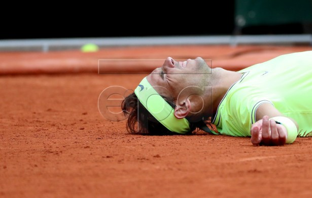 Rafael Nadal of Spain reacts after winning the men?s final match against Dominic Thiem of Austria during the French Open tennis tournament at Roland Garros in Paris, France, 09 June 2019. Nadal won the French Open title 12th times. EPA-EFE/SRDJAN SUKI