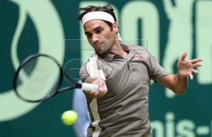 Roger Federer from Switzerland in action during his first round match against John Millman from Australia at the ATP Tennis Tournament Gerry Weber Open in Halle Westphalia, Germany, 18 June 2019. EPA-EFE/FRIEDEMANN VOGEL