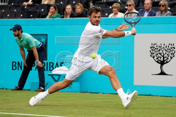 Switzerland's Stan Wawrinka in action during his round 32 match against Britain's Dan Evans at the Fever Tree Championship at Queen's Club in London, Britain, 19 June 2019. EPA-EFE/WILL OLIVER