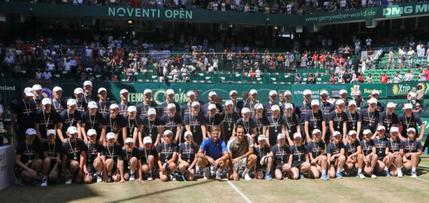 Roger Federer (C-R) and from Switzerland poses with the ball kids after the final match against David Goffin from Belgium (C-L) at the ATP Tennis Tournament Noventi Open (former Gerry Weber Open) in Halle Westphalia, Germany, 23 June 2019. EPA-EFE/FOCKE STRANGMANN