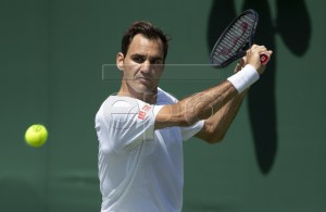 Roger Federer of Switzerland hits a ball during a training session at the All England Lawn Tennis Championships in Wimbledon, London, on Thursday, June 27, 2019. EPA-EFE/PETER KLAUNZER EDITORIAL USE ONLY; NO SALES, NO ARCHIVES