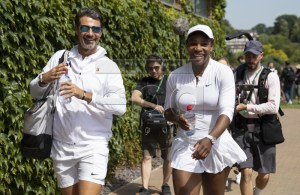 Serena Williams (R0 of USA and her coach Patrick Mouratoglou walk on after a training session at the All England Lawn Tennis Championships in Wimbledon, London 28 June 2019. EPA-EFE/PETER KLAUNZER EDITORIAL USE ONLY; NO SALES, NO ARCHIVES