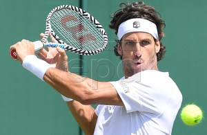 Feliciano Lopez of Spain in action against Marcos Giron of the USA in their first round match during the Wimbledon Championships at the All England Lawn Tennis Club, in London, Britain, 01 July 2019. EPA-EFE/ANDY RAIN EDITORIAL USE ONLY/NO COMMERCIAL SALES