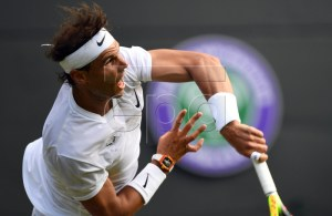 Rafael Nadal of Spain serves to Yuichi Sugita of Japan in their first round match during the Wimbledon Championships at the All England Lawn Tennis Club, in London, Britain, 02 July 2019. EPA-EFE/FACUNDO ARRIZABALAGA EDITORIAL USE ONLY/NO COMMERCIAL SALES