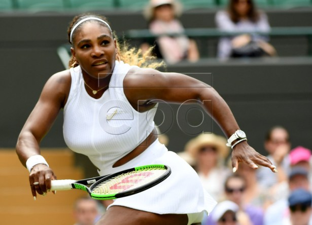 Serena Williams of the USA in action against Carla Suarez Navarro of Spain during their fourth round match for the Wimbledon Championships at the All England Lawn Tennis Club, in London, Britain, 08 July 2019. EPA-EFE/ANDY RAIN EDITORIAL USE ONLY/NO COMMERCIAL SALES