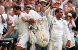 Roger Federer of Switzerland (L) and Rafael Nadal of Spain exit Centre Court following their semi final match during the Wimbledon Championships at the All England Lawn Tennis Club, in London, Britain, 12 July 2019. EPA-EFE/NIC BOTHMA EDITORIAL USE ONLY/NO COMMERCIAL SALES