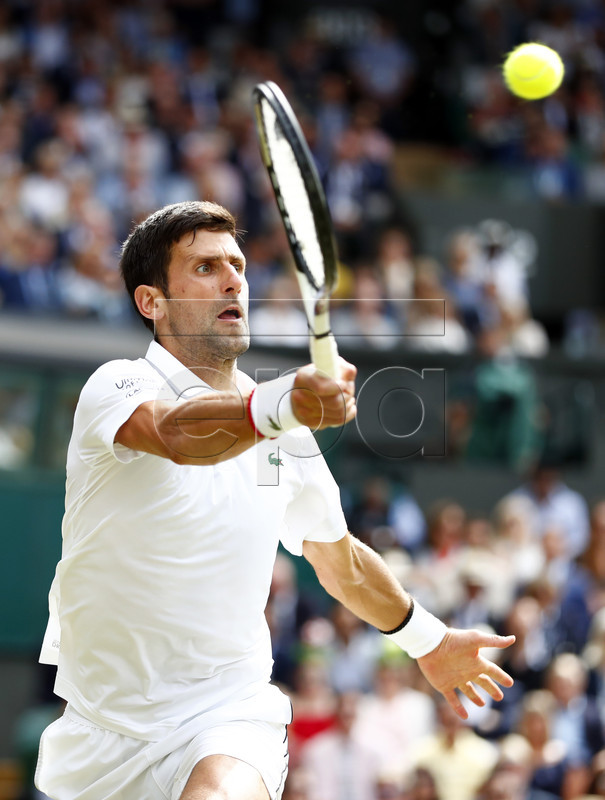 Novak Djokovic of Serbia returns to Roger Federer of Switzerland in the men's final of the Wimbledon Championships at the All England Lawn Tennis Club, in London, Britain, 14 July 2019. EPA-EFE/NIC BOTHMA EDITORIAL USE ONLY/NO COMMERCIAL SALES