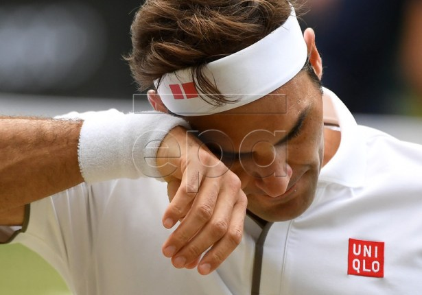 Roger Federer of Switzerland in action against Novak Djokovic of Serbia during their Men's final match for the Wimbledon Championships at the All England Lawn Tennis Club, in London, Britain, 14 July 2019. EPA-EFE/ANDY RAIN EDITORIAL USE ONLY/NO COMMERCIAL SALES