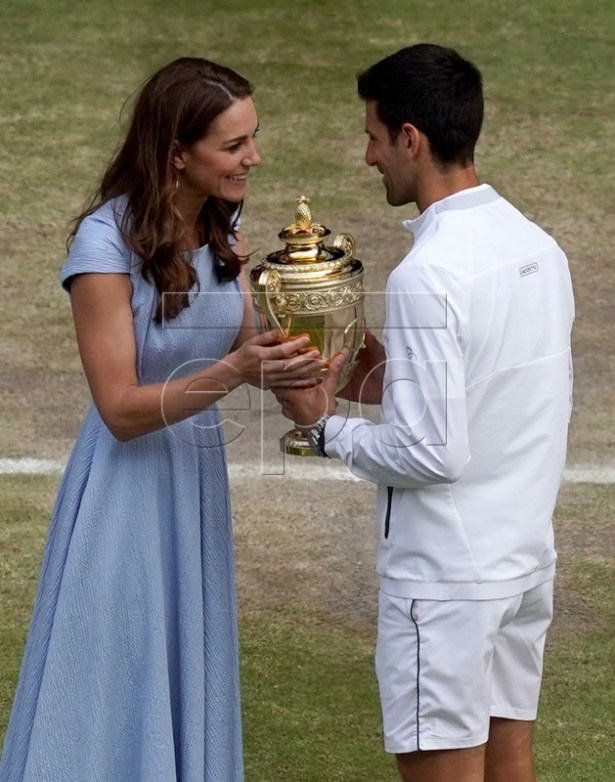 Novak Djokovic of Serbia receives the trophy from Catherine (L), the Duchess of Cambridge, after winning against Roger Federer of Switzerland during their Men's final match for the Wimbledon Championships at the All England Lawn Tennis Club, in London, Britain, 14 July 2019. EPA-EFE/WILL OLIVER EDITORIAL USE ONLY/NO COMMERCIAL SALES