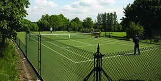 Tennis court fences remove the need for hedging and deter moss.