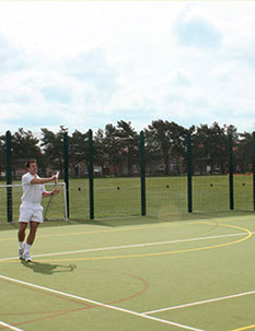 Playing tennis on a multi use games area