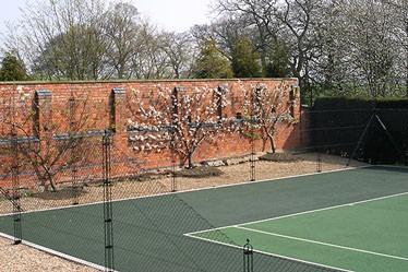 Two-tone Pladek tennis court surface in green by En Tout Cas
