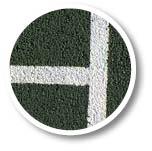 Close-up of Pladek tennis court surface in green by En Tout Cas