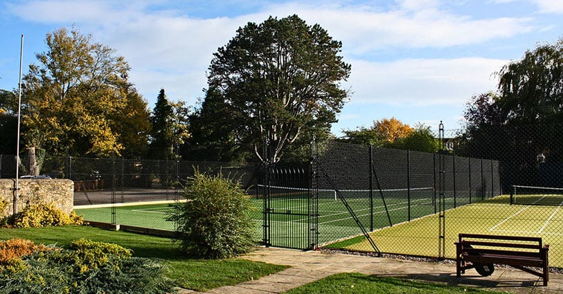 Tennis court fencing with obelisk supports from En Tout Cas at Woodstock Tennis Club