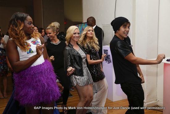 Tennis Player Sloane Stephens, actress Brittany Snow, and Austin Mahone plays the highly anticipated Just Dance 2014, due out in October at the Just Dance with Boy Meets Girl fashion show, Thursday, September 12, 2013, in New York City.(Photo by Mark Von Holden/Invision for Just Dance/AP Images)