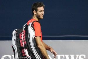 Del Potro smiles with racquet bag