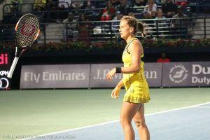06-220 Strycova tosses racquet