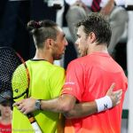 227 Wawrinka and Baghdatis hug at net