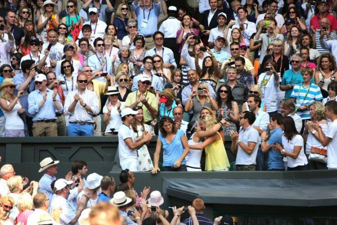 Marion Bartoli hugs her Fed Cup team mate Kiki Mladenovic after winning her first Slam at Wimbledon