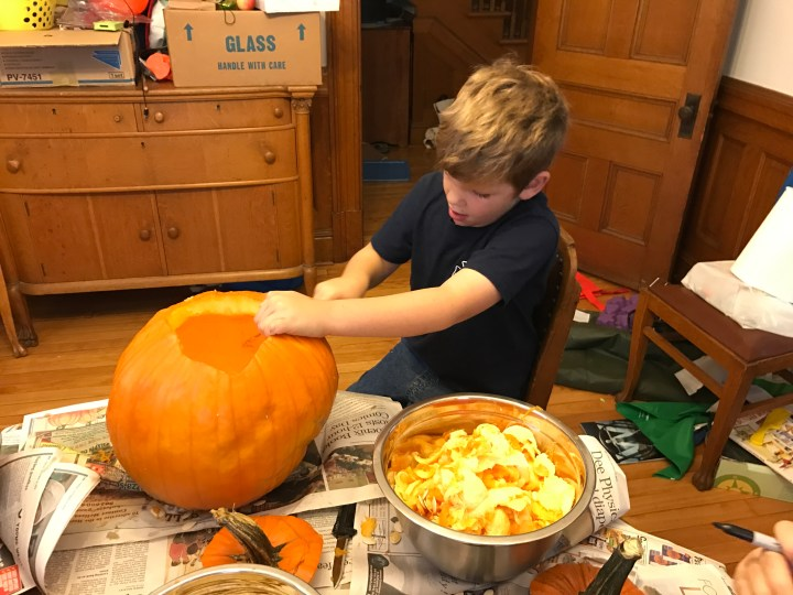 Edward Carving his Pumpkin