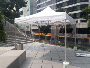 Party Tent with water weights at design orchard rooftop