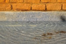 Brick meets stone meets water- with a trip breaking stillness. Photo by Kevin McConnell