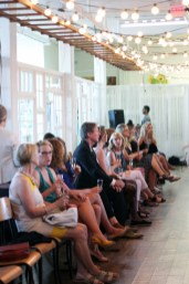 Guests mingle while enjoying complimentary bubbly and canapés before the start of the fashion show.