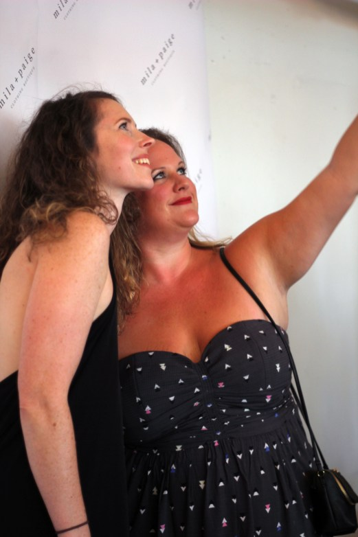 Mila + Paige owner Anita Dunn taking a selfie at the media wall.