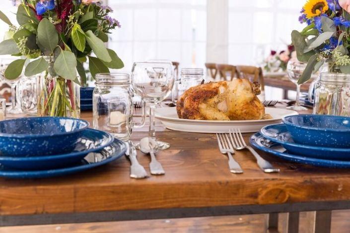 Farm Table With Hammered Silverware, Mason Jar Glasses & Western Blue Plates