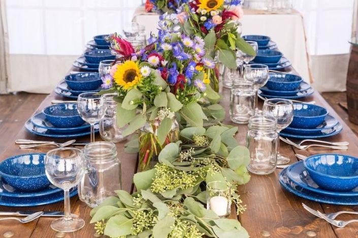 Farm Table With Western Blue China, Napa Wine Glasses & Mason Jars
