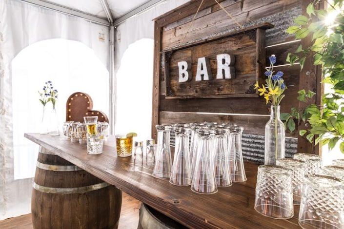 Rustic Whiskey Barrel Bar, Pilsner Glasses & Barnwood Decor Wall With Bar Sign