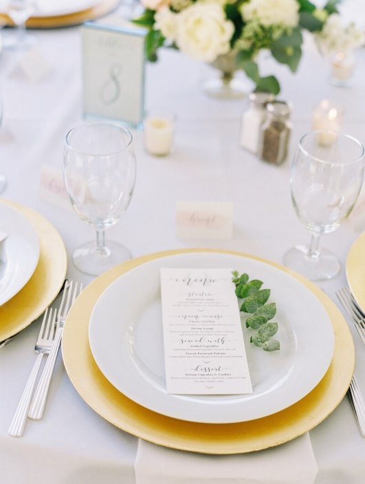 Place Setting With Deco Silverware, Napa Glassware, White China & Gold Chargers