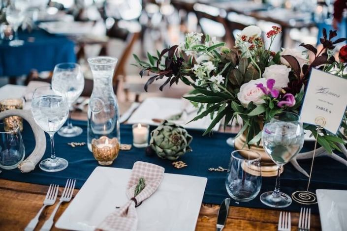Farm Table With Square Plates, Hammered Flatware, Water Carafs & Stemless Wine Glasses