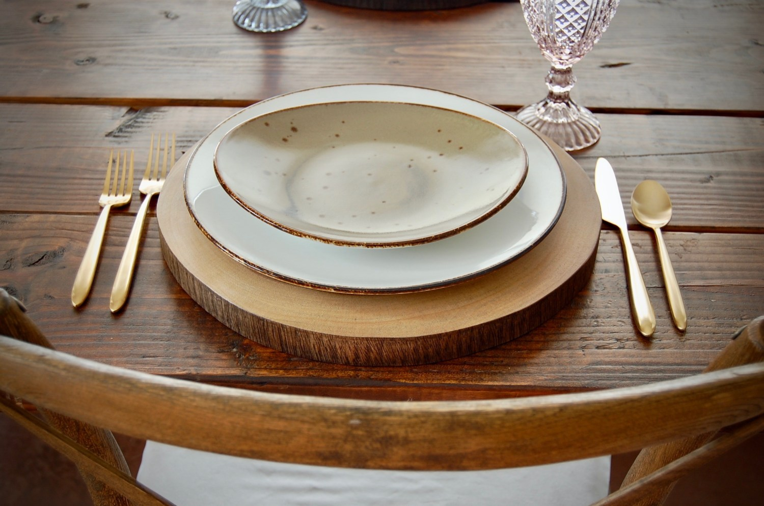 wood slice charger gold flatware and rustic plates