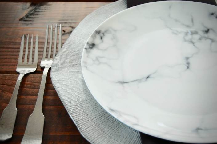 china rental- marble plate silver charger with hammered flatware