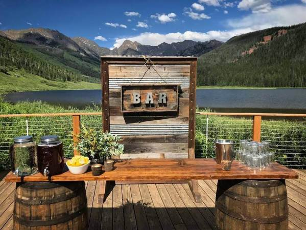 Whskey Barrel Bar with Rustic Bar Sign Piney River Ranch