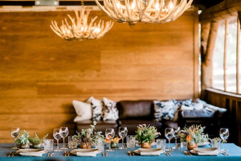 Western table setting with antler chandeliers
