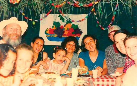 Author with family and guests in Sukkah