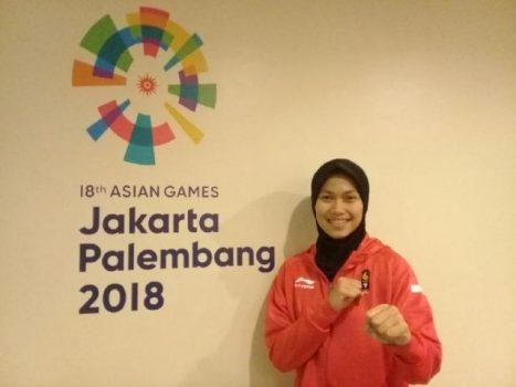 Atlet taekwondo Asian Games 2018 asal Indonesia nomor individu poomsae, Defia Rosmaniar, seusai berlatih di Jakarta Convention Center, Jumat, 17 Agustus 2018. Tempo/Bram Setiawan
