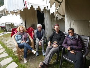 The four trekkers resting at the base camp Gangaria, Valley of Flowers, Himalayan India