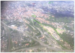 View over Vilnius from the air, shortly after take-off, through rather grubby aircraft windows. Some tfLT projects and office highlighted