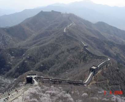 The Great Wall of China snakes its way across the mountains like a serpent.