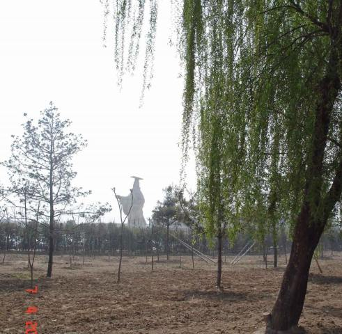 Emperor Qin rising through the mist as you approach the on site Museum of  Army of Terracotta soldiers
