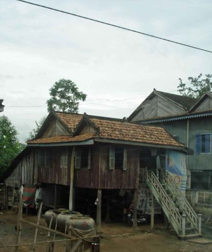 Traditional Homes - large clay vessels for water storage. Country-Cambodia