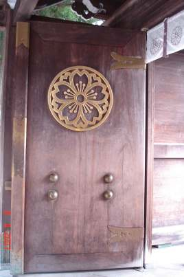 Burnished timber  entrance Door to interior of Sakurayama Hachiman Shrine