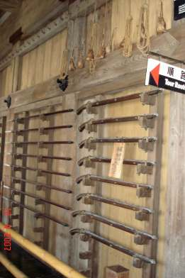 Racks of flintlocks and gun powder pouches-Himeji Castle
